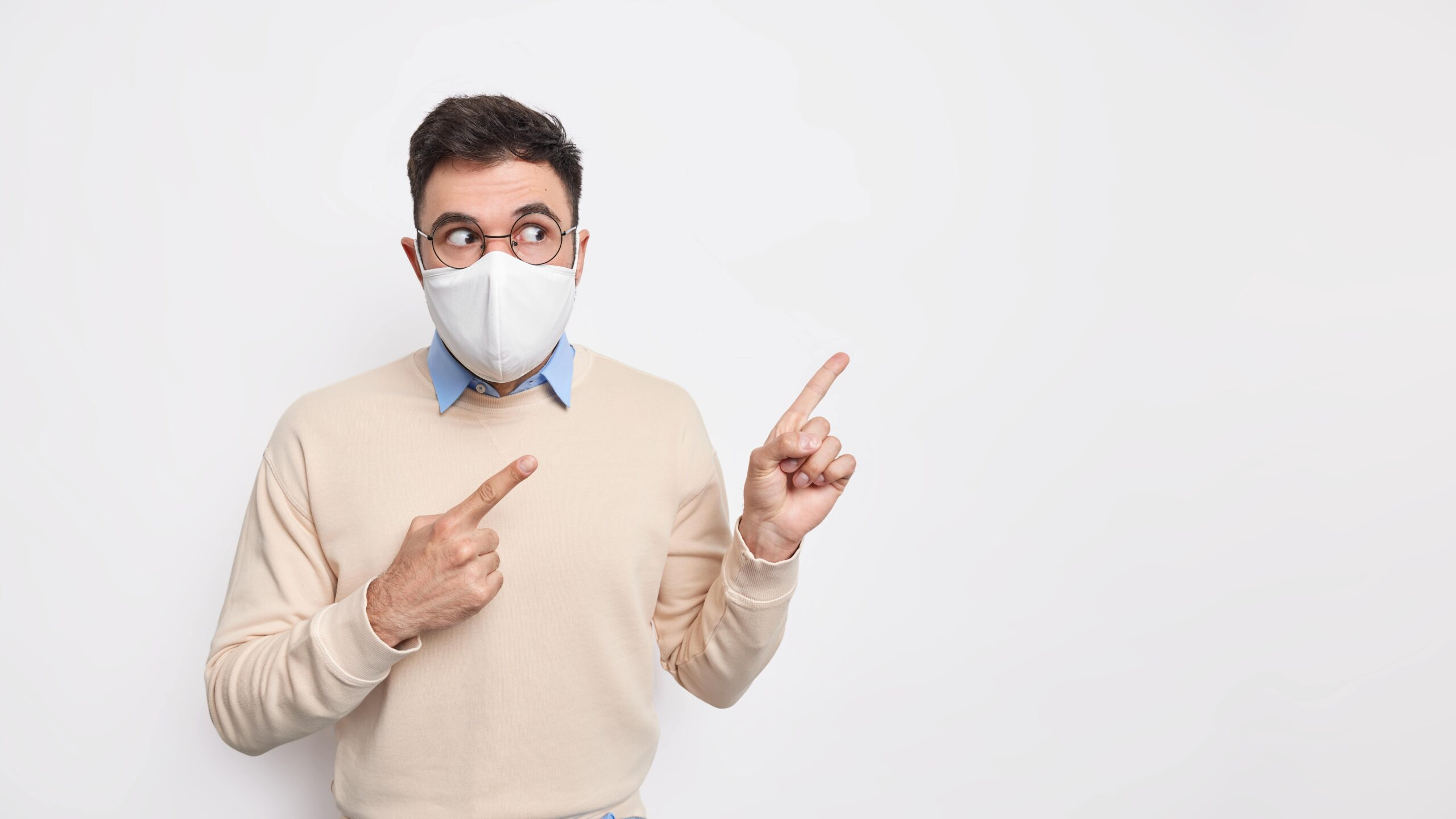 indoor-studio-shot-shocked-adult-man-wears-protective-face-mask-prevent-coronavirus-has-surprised-face-expression
